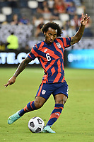 KANSAS CITY, KS - JULY 15: Gianluca Busio #6 of the United States takes a free kick during a game between Martinique and USMNT at Children's Mercy Park on July 15, 2021 in Kansas City, Kansas.