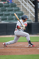 Drew Stankiewicz (15) of the Lakewood BlueClaws follows through on his swing against the Kannapolis Intimidators at Intimidators Stadium on July 14, 2015 in Kannapolis, North Carolina.  The Intimidators defeated the BlueClaws 8-2.  (Brian Westerholt/Four Seam Images)