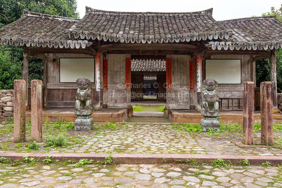 Yubei, Zhejiang, China.  300-year-old Village Meeting Hall, Shi Guardian Lion (Foo Dog) Guarding Entrance.