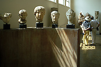 A variety of carved marble heads from ancient Greece. Most of these were part of larger, perhaps full-length, statues. National Museum of Archaeology.