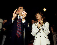 "Montreal (Qc) CANADA - File Photo - Jan 1996 -<br /> Lucien Bouchard,  Leader Parti Quebecois (from Jan 29, 1996 to March 2, 2001). seen in a file photo with wife Audrey Best.<br /> <br /> After the Yes side lost the 1995 referendum, Parizeau resigned as Quebec premier. Bouchard resigned his seat in Parliament in 1996, and became the leader of the Parti QuÈbÈcois and premier of Quebec.<br /> <br /> On the matter of sovereignty, while in office, he stated that no new referendum would be held, at least for the time being. A main concern of the Bouchard government, considered part of the necessary conditions gagnantes (""winning conditions"" for the feasibility of a new referendum on sovereignty), was economic recovery through the achievement of ""zero deficit"". Long-term Keynesian policies resulting from the ""Quebec model"", developed by both PQ governments in the past and the previous Liberal government had left a substantial deficit in the provincial budget.<br /> <br /> Bouchard retired from politics in 2001, and was replaced as Quebec premier by Bernard Landry."