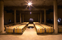 The barrel aging cellar, with a hole in the wall and a hole in the floor to show the soil and rock type and to give humidity from the underground river that flows beneath the cellar, at Vignoble Tour de Verdots in Bergerac, owned by David Fourtout The very dramatic newly built underground barrel aging cellar under the winery, with rows of barrels. In the walls and in the floor there are oval openings that show the soil structure and the underground river that flows underneath the winery Domaine Vignoble des Verdots Conne de Labarde Bergerac Dordogne France