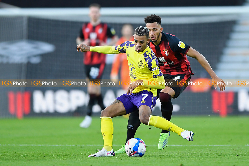 Juninho Bacuna of Huddersfield Town is tracked by Lloyd Kelly of AFC Bournemouth during AFC Bournemouth vs Huddersfield Town, Sky Bet EFL Championship Football at the Vitality Stadium on 12th December 2020