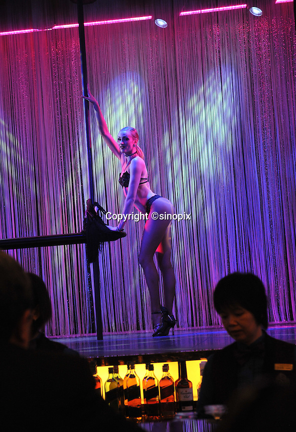 """Dancers perform at a bar in the New Lisboa Casino in Macau, 25th October 2008.  Macau is known simply as """"Vegas"""" in China. The former Potuguese colony, now a Chinese Special Administrative Region, attracts millions of Chinese gamblers annually and last year earned more gambling dollars than Las Vegas."""