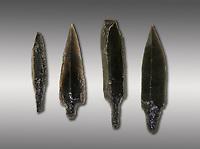 Black obsidian arrow heads. Catalhoyuk Collections. Museum of Anatolian Civilisations, Ankara. Against a grey background