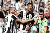 Calcio, Serie A: Juventus vs Crotone. Torino, Juventus Stadium, 21 maggio 2017.<br /> Juventus' Alex Sandro, right, celebrates with his teammate Leonardo Bonucci after scoring during the Italian Serie A football match between Juventus and Crotone at Turin's Juventus Stadium, 21 May 2017. Juventus defeated Crotone 3-0 to win the sixth consecutive Scudetto.<br /> UPDATE IMAGES PRESS/Isabella Bonotto