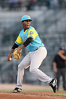 Starting pitcher Roansy Contreras (7) of the Charleston RiverDogs, playing as the Perros Santos de Charleston, in a game against the Columbia Fireflies on Friday, July 12, 2019 at Segra Park in Columbia, South Carolina. The RiverDogs won, 4-3, in 10 innings. (Tom Priddy/Four Seam Images)