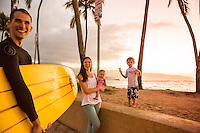 A happy family of four at Hale'iwa Beach Park, North Shore, O'ahu.