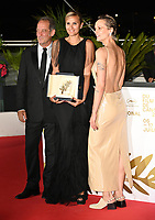 CANNES, FRANCE. July 17, 2021: Vincent Lindon, Julia Ducournau & Agathe Rousselle at the photocall for Cannes Awards 2021 at the 74th Festival de Cannes.<br /> Picture: Paul Smith / Featureflash