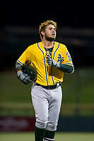 AZL Athletics right fielder Enrry Pantoja (16) jogs to the dugout between innings during a game against the AZL Cubs on August 9, 2017 at Sloan Park in Mesa, Arizona. AZL Athletics defeated the AZL Cubs 7-2. (Zachary Lucy/Four Seam Images)