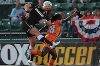 Brittany Bock (WNY Flash) heads the ball away from Sky Blue\'s Eniola Aluko during a June 3rd match that ended in a 2-2 tie (Rochester, NY)