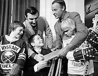 Big moment for small boys: Stephen Layton; who is Timmy 1972; gets autographs of two newly retired hockey stars; Montreal Canadiens' John Ferugson and Detroit Red Wings great Gordie Howe; at annual Sports Celebrities Dinner. Watching are pair of 9-year-olds; Neil McGuire (left) and Peter Jenkins; who will play in Timmy Tyke hockey tourney at Gardens. Dinner started Easter Seals Campaign.<br /> <br /> Photo : Boris Spremo - Toronto Star archives - AQP