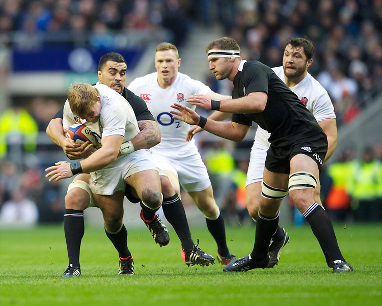 Tom Youngs of England drives forward as he is tackled by Liam Messam of New Zealand during the QBE Autumn International match between England and New Zealand at Twickenham on Saturday 01 December 2012 (Photo by Rob Munro)