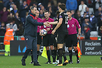 Swansea City manager Paul Clements shakes hands with Harry Maguire of Leicester City after the final whistle of the Premier League match between Swansea City and Leicester City at The Liberty Stadium, Swansea, Wales, UK. Saturday 21 October 2017