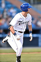 Asheville Tourists left fielder Sam Hilliard (25) runs to first during a game against the Rome Braves at McCormick Field on April 14, 2016 in Asheville, North Carolina. The Braves defeated the Tourists 4-3. (Tony Farlow/Four Seam Images)