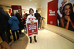 Ottawa, ON - March 28 2014- Sochi 2014 Paralympian Caroline Bisson of the para-Nordic skiing and biathlon team displays her limited edition gold-plated coin and personalized Welcome Home banner at the CIBC Paralympic Welcome Home Event at CIBC South Keys Banking Centre in Ottawa (Photo: Patrick Doyle/CIBC)
