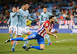Yannick Ferreira Carrasco of Atletico de Madrid gets tripped during their La Liga match between Atletico de Madrid and RC Celta de Vigo at the Vicente Calderón Stadium on 12 February 2017 in Madrid, Spain. Photo by Diego Gonzalez Souto / Power Sport Images