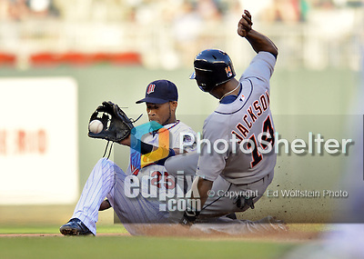 29 September 2012: Minnesota Twins shortstop Pedro Florimon manages to get the ball a split second late as Detroit Tigers center fielder Austin Jackson slides safely into second with his 12th stolen base of the season in the top of the 8th inning against the Minnesota Twins at Target Field in Minneapolis, MN. The Tigers defeated the Twins 6-4 in the second game of their 3-game series. Mandatory Credit: Ed Wolfstein Photo