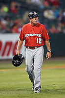 Oklahoma City RedHawks interim manager Tom Lawless (12) walking off the field during a game against the Memphis Redbirds on May 23, 2014 at AutoZone Park in Memphis, Tennessee.  Oklahoma City defeated Memphis 12-10.  (Mike Janes/Four Seam Images)