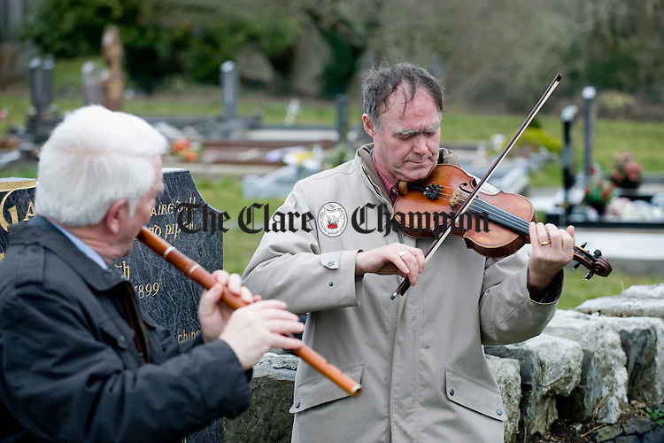 Antoin Mc Gabhan playing  at the funeral of musician Joe Ryan in Inagh.