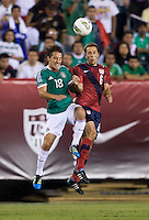 Steve Cherundolo (6) of the USMNT goes up for a header with Andres Guardado (18) of Mexico during the game at Lincoln Financial Field in Philadelphia, PA. The USMNT tied Mexico, 1-1.