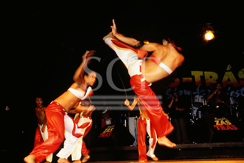 Natal, Brazil. Group of dancers in red and white giving a capoeira demonstration at a folklore show.