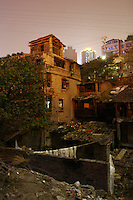 CHINA. Sichuan Province. Chongqing. Old neighbourhoods next to The Yangtze River which is at its lowest level in 150 years as a result of a country-wide drought. Chongqing is a city of over 3,000,000 people, famed for being the capital of China between 1938 and 1946 during World War II. It is situated on the banks of the Yangtze river, China's longest river and the third longest in the world. Originating in Tibet, the river flows for 3,964 miles (6,380km) through central China into the East China Sea at Shanghai.  2008.