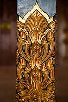 Yogyakarta, Java, Indonesia.  Lotus Flower Design Carved on a Pillar Supporting Roof of a Replica of the Sultan's Bedroom.  Ndalem Ngabean Restaurant.