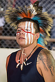 A Native American contestant from the USA with white and red face paint  prepares for his next event during the International Indigenous Games, in the city of Palmas, Tocantins State, Brazil. Photo © Sue Cunningham, pictures@scphotographic.com 27th October 2015