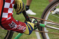 13 SEP 2014 - IPSWICH, GBR - A competitor cleans his bike during a break in racing at the 2014 British Open Club Cycle Speedway Championships at Whitton Sports & Community Centre in Ipswich, Great Britain (PHOTO COPYRIGHT © 2014 NIGEL FARROW, ALL RIGHTS RESERVED)