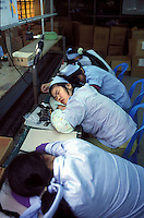 Workers sleep on their break on an assembly line in Guangzhou, China..NOV-96