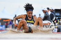 Zinnia Miller of Iowa lands in the sand trap in first round of triple jump during West Preliminary Track & Field Championships at John McDonnell Field, Friday, May 30, 2014 in Fayetteville, Ark. (Mo Khursheed/TFV Media via AP Images)