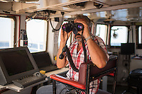Sea Watch-2.<br /> Die Sea Watch-2 ist zu ihrer 13. SAR-Mission vor der libyschen Kueste.<br /> Im Bild: Ein Besatzungsmitglied auf der Bruecke.<br /> 18.10.2016, Mediterranean Sea<br /> Copyright: Christian-Ditsch.de<br /> [Inhaltsveraendernde Manipulation des Fotos nur nach ausdruecklicher Genehmigung des Fotografen. Vereinbarungen ueber Abtretung von Persoenlichkeitsrechten/Model Release der abgebildeten Person/Personen liegen nicht vor. NO MODEL RELEASE! Nur fuer Redaktionelle Zwecke. Don't publish without copyright Christian-Ditsch.de, Veroeffentlichung nur mit Fotografennennung, sowie gegen Honorar, MwSt. und Beleg. Konto: I N G - D i B a, IBAN DE58500105175400192269, BIC INGDDEFFXXX, Kontakt: post@christian-ditsch.de<br /> Bei der Bearbeitung der Dateiinformationen darf die Urheberkennzeichnung in den EXIF- und  IPTC-Daten nicht entfernt werden, diese sind in digitalen Medien nach §95c UrhG rechtlich geschuetzt. Der Urhebervermerk wird gemaess §13 UrhG verlangt.]