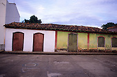 Santarem, Brazil. Small shops with tiled roofs and shuttered windows and doors. Para State.