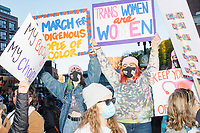 """Protestors gather near the statue of Samuel Adams outside Faneuil Hall at the end of the 2020 Women's March protest in opposition to the re-election of US president Donald Trump in Boston, Massachusetts, on Sat., Oct. 17, 2020.<br /> The signs here read """"My body / My choice,"""" """"I march for indigenous people of color,"""" """"Trans women are women,"""" and """"Keep your hands off my body."""""""