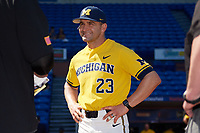 Michigan Wolverines head coach Erik Bakich (23) during the lineup exchange before a game against Army West Point on February 17, 2018 at Tradition Field in St. Lucie, Florida.  Army defeated Michigan 4-3.  (Mike Janes/Four Seam Images)