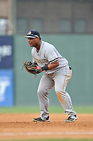 First baseman Leonard (Bo) Thompson (38) of the Charleston RiverDogs in a game against the Greenville Drive on Sunday, August 16, 2015, at Fluor Field at the West End in Greenville, South Carolina. Thompson is a product of The Citadel and J.L. Mann High School in Greenville. Charleston won, 6-2. (Tom Priddy/Four Seam Images)