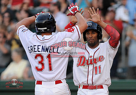 Bo Greenwell (31) of the Greenville Drive is congratulated after hitting a home run in a game against the Lexington Legends on Thursday, April 24, 2014, at Fluor Field at the West End in Greenville, South Carolina. (Tom Priddy/Four Seam Images)