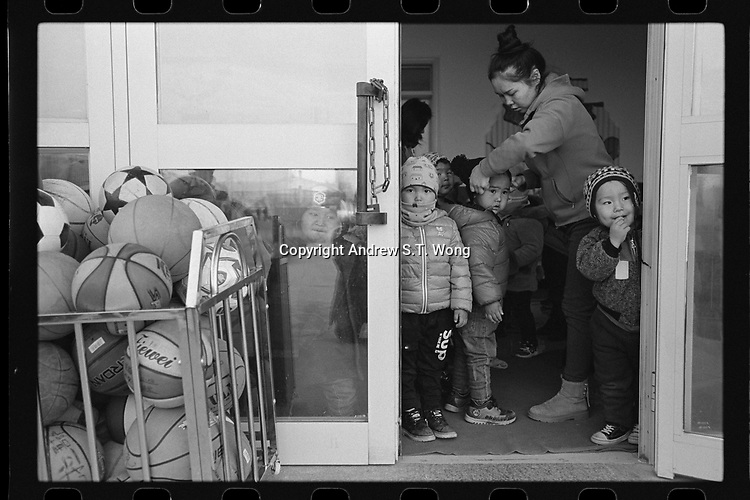 Jeminay County, Xinjiang Uygur Autonomous Region, China - Students prepare to leave a nursery for home, October 2019.