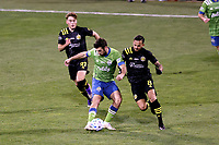 COLUMBUS, OH - DECEMBER 12: Will Bruin #17 of the Seattle Sounders FC plays the ball past Artur #8 of the Columbus Crew during a game between Seattle Sounders FC and Columbus Crew at MAPFRE Stadium on December 12, 2020 in Columbus, Ohio.