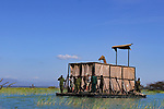 Giraffe rescue using raft in flood waters by Tony Crocetta/Naturagency