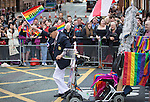 "© Joel Goodman - 07973 332324 . 23/08/2014 .  Manchester , UK . The oldest gay in the village gets off his mobility scooter to wave his pride flag . The parade through Manchester City Centre . Manchester Pride "" Big Weekend "" in Manchester "" today ( 23rd August 2014 ) . Photo credit : Joel Goodman"