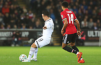 Roque Mesa of Swansea City is marked by Jesse Lingard of Manchester United during the Carabao Cup Fourth Round match between Swansea City and Manchester United at the Liberty Stadium, Swansea, Wales, UK. Tuesday 24 October 2017
