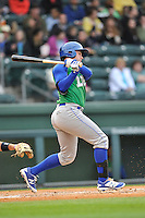 Third baseman Travis Maezes (4) of the Lexington Legends bats in a game against the Greenville Drive on Thursday May 19, 2016, at Fluor Field at the West End in Greenville, South Carolina. (Tom Priddy/Four Seam Images)