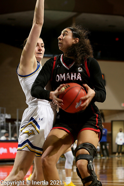 SIOUX FALLS, SD - MARCH 6: Josie Filer #25 of the Omaha Mavericks takes the ball to the basket against Kallie Theisen #12 of the South Dakota State Jackrabbits during the Summit League Basketball Tournament at the Sanford Pentagon in Sioux Falls, SD. (Photo by Dave Eggen/Inertia)