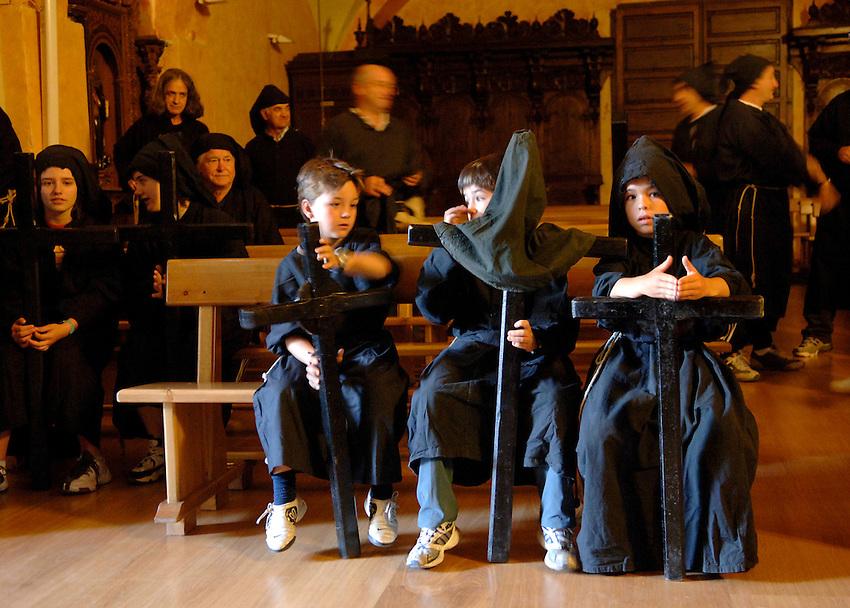 IRUNBERRI - LUMBIER, NAVARRE - JUNE 11: Penitents dressed in black monk habits wait for the start of the celebration of the 'Cruceros' brotherhood penitential pilgrimage to the 'Ermita de la Trinidad' on June 11, 2006 in Irunberri - Lumbier, Navarre.