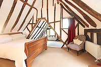 BNPS.co.uk (01202 558833)<br /> Pic: Cheffins/BNPS<br /> <br /> Pictured: There are three bedrooms<br /> <br /> Crime history fans can live in the home of notorious highwayman Dick Turpin for £1,950 a month.<br /> <br /> The infamous criminal ran a butcher's shop from this pretty thatched cottage before he joined a deer thief gang in the 1730s.<br /> <br /> Turpin was born opposite this house at the Bluebell Inn and staged cockfights in a grass area opposite the house which is still known as Turpin's ring.<br /> <br /> Robert Palmer bought the Grade II Listed Dick Turpin's Cottage in Hempstead, Essex, in 2012 and spent eight years gutting and refurbishing the house to make it more suitable for modern living.