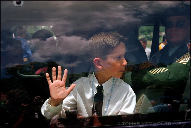 The son of  U.S. Army Spc. Richard Orengo leaves the cemetery where his father was buried in Bayamon in the United States territory of Puerto Rico on July 5, 2003. Orgengo was shot in Iraq on June 26 while investigating a car theft.