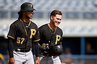 FCL Pirates Black Jake Wright (93) smiles as he walks to first base with Luis Hernandez (57) after getting hit in the face by a pitch during a game against the FCL Rays on August 3, 2021 at Charlotte Sports Park in Port Charlotte, Florida.  (Mike Janes/Four Seam Images)