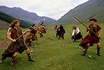 'CLAN, THE' SCOTLAND, A GROUP WHO SPEND THEIR WEEKENDS AT A CAMP IN GLEN CROE, RECREATING THE LIFE OF A SCOTTISH CLAN BEFORE THE DEFEAT OF BONNIE PRINCE CHARLIE BY THE ENGLISH AT THE BATTLE OF CULLODEN IN 1746. WHILE THE WOMEN COOK LUNCH, THE MEN PRACTICE FIGHTING IN PAIRS PRIOR TO REENACTING OLD CLAN BATTLES, 1989
